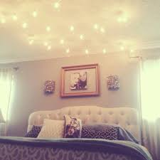 Break all the rules and hang globe string lights above the bed. Instant  mood lighting