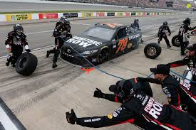 furniture row racing 2017. pits during the pure michigan 400 at international speedway on august 13, 2017. photo by brian lawdermilk/getty images. furniture row racing 2017 e