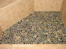 pebble shower floor shows rounded river rocks in a tile home depot