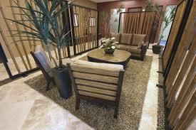 Zen Living Room Decorating Bamboo Screen Walls And A Pebbled Stone Border Physically And