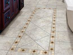 gray tile floor with inset diamond mosaic
