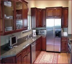 Small Kitchen With Cabinets And Stainless Steel Refrigerator Tips