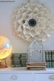 repurpose old book pages into beautiful flower like wall art
