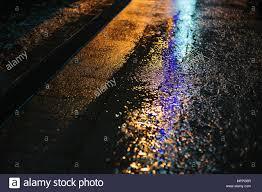 Light Colored Asphalt Colored Light On Wet Asphalt In Night City Background Stock
