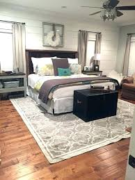 what size rug under king bed underneath area masculine rugs furniture s singapore