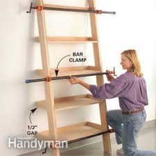 How to build a shelf unit Closet Photo 9 Clamp The Unit Until The Glue Dries The Family Handyman Leaning Tower Of Shelves The Family Handyman