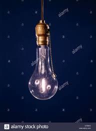 lightbulbs bare. SINGLE BARE LIGHT BULB LIT WITH PULL CHAIN - Stock Image Lightbulbs Bare X