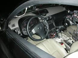2004 nissan 350z interior. i also threw in a jdm steering wheel and 2004 updated center console nissan 350z interior