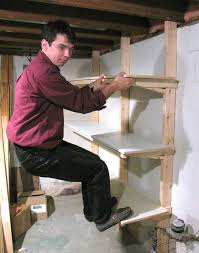 here s testing the strength of the shelf the verticals are ed directly into the floor joists above so it s strong enough