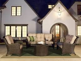 Exterior Beige Cape May Wicker On Pea Gravel Patio And Wooden Cape May Outdoor Furniture