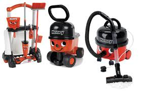a per henry prize from casdon consisting of a henry vacuum a henry cleaning trolley