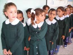 the school uniform debate pros and cons of school uniforms  girls lining up for class via