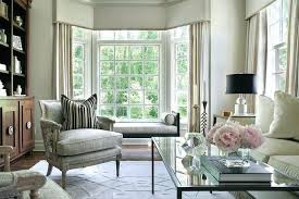 living room with bay window living room bay window with black chaise lounge bench living room living room with bay window