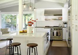 cool white traditional kitchen with industrial chairs and quartz countertop