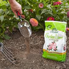 adding garden lime to acidic soil