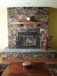 Terrific Stone Fireplace Surround Ideas With Agreeable Wooden Shelf Design  And Licious Black Steel Door Ideas