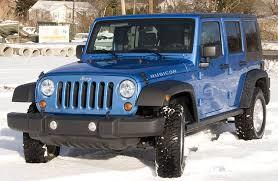 jeep wrangler 4 door hardtop on snow