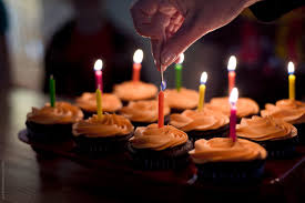 Lighting The Candles On Birthday Cupcakes Stocksy United