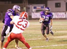Nick Pascarella of Carlsbad with blockers out front managed to ...