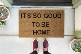 looking to buy a house.  House A Person Stands In Front Of A Welcome Mat That Says  Throughout Looking To Buy House L