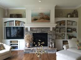 gas fireplace with stacked stone pieced hearth corbels board and batten detail above the mantle and built ins on both sides modern fireplace