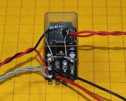 dual coil relay once around the red black wires from the left supply power the grey ones go to the start switch the double red wires go to the reed switch and the remaining red black