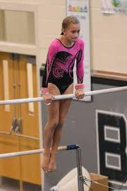 Summer Salt Gymnastics Invitational - Madeline Sims, level 4, finishing her  kip on the high bar. | Palm Coast Observer