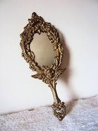 fancy hand mirror. vintage gilt hand mirror art nouveau style with cherub angel fancy