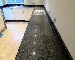 white kitchen cabinets dark gray granite countertops
