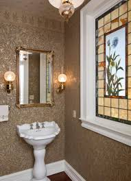 beautiful powder room with pretty standing sink and mirror also lovely wall sconces and pendant along