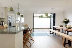 this cool and contemporary space although not overly large has been cleverly arranged to make the most of the room available with bifold doors linking
