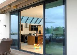 an aluminium sliding door adds eye catching impact to the exterior of a home the outward appearance focuses on stunning glass areas highlighted by bold