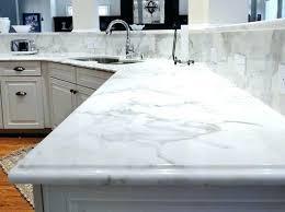quartz kitchen cabinets update ideas on a budget like marble carrara look silestone in photo courtesy quartz vs marble