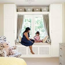 use ikea wardrobe units to create built ins around a window seat 27