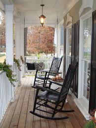 front porch decoration using pair of black stained wooden rocking chair in front of white wooden