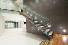 contemporary staircase with glass and steel railing