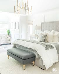 neutral master bedroom with modern gray tufted bed and white simply white benjamin moore walls