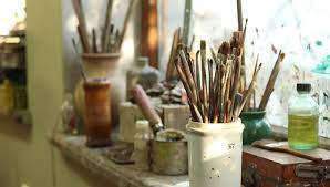 oil painting brushes various dirty paint brushes in a jar hd stock