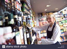 s assistant arranging goods on the shelves stock photo s assistant arranging goods on the shelves