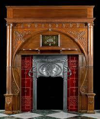 carved oak art nouveau antique fireplace mantel and integral cast iron insert