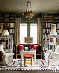 i fell in love with the wallpapered ceiling the paul ferrante light fixture and the olive green paint color on the shelves