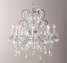 you can t deny how much a beautiful chandelier changes a space if you are a chandelier person you know that all crystal chandeliers are