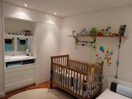 lighting for baby room. brown varnished wood cradle bookshelves colorful plastic baby mobile white lacquered changing table blue green lighting for room o