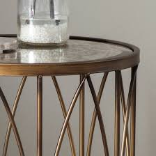 close up of mottled vintage mirror table top antique gold round side table