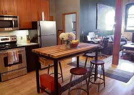 custom made butcher block kitchen island with industrial base and wine rack