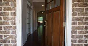 front home entrance door open rise up rising shot of the front entrance as the door opens to reveal the hallway of a modern residential home stock video
