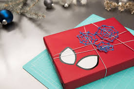 diy gift wrapping paper inspired by spider man into the spider verse disney diy by disney family