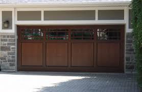 custom wood doors offer by b m garage door inc