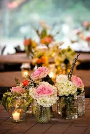 small vases with floral groupings