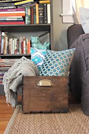 old and vintage wooden diy blanket storage box in living room beside wall bookshelf ideas